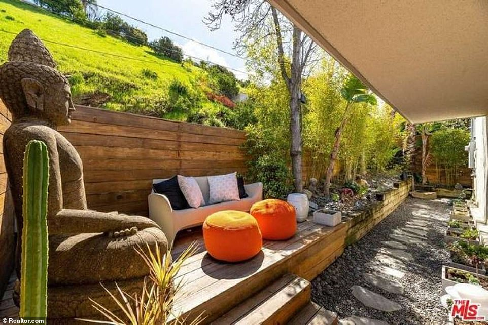There is a comfortable seating area at the back of the home as the property is nestled on a hilltop with lots of greenery