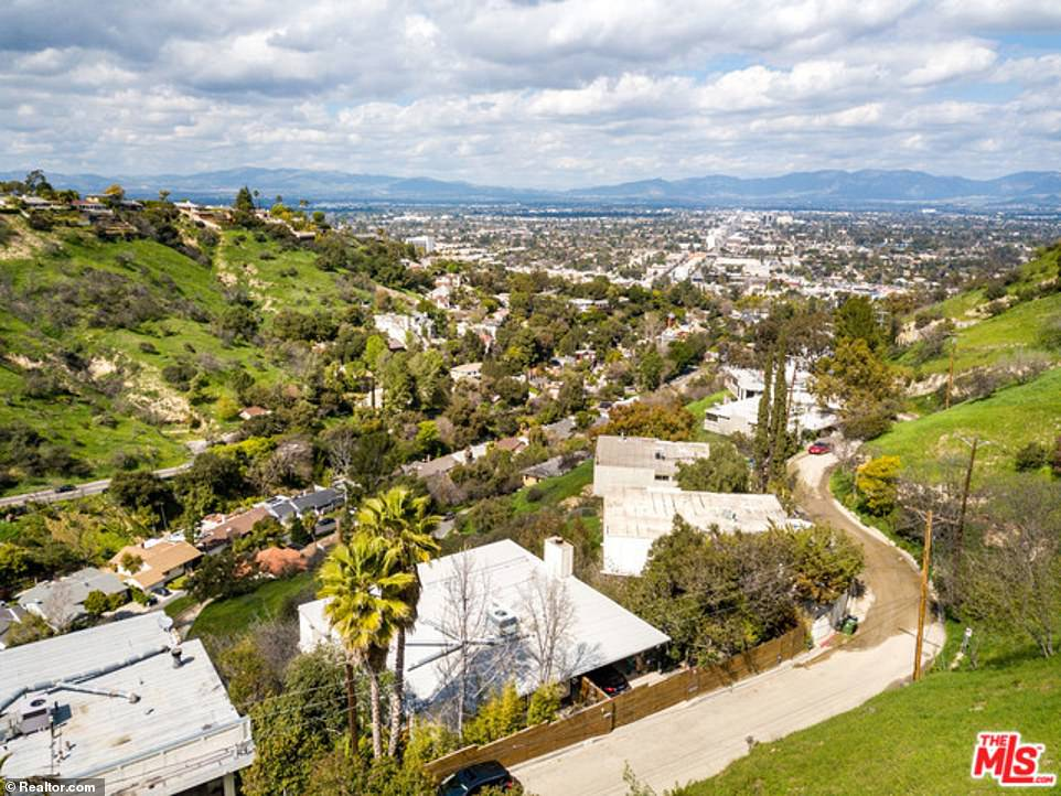 The property boasts breathtaking views of the San Fernando Valley as it is built upon the summit of a canyon