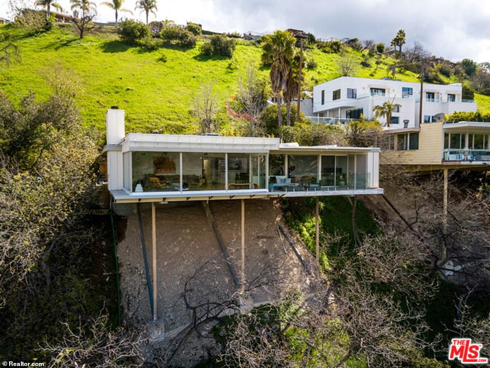 A famous house that is built on stilts, (pictured), in Sherman Oaks, California is on the market with a price tag of $1.5 million