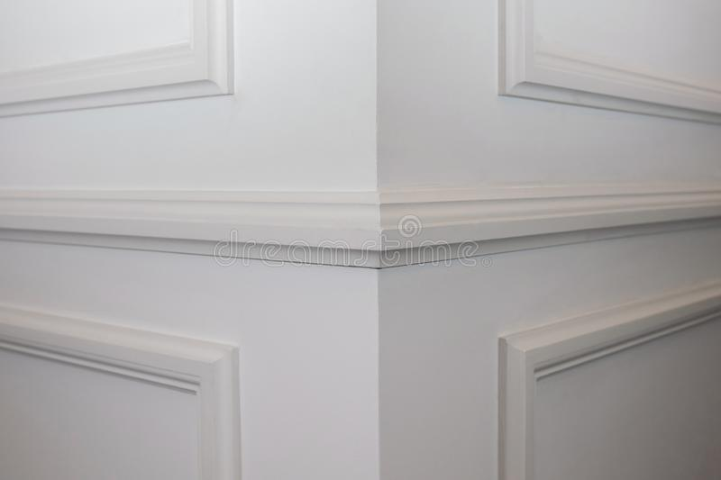 Ceiling moldings in the interior, detail of a angular wall skirting. stock photo