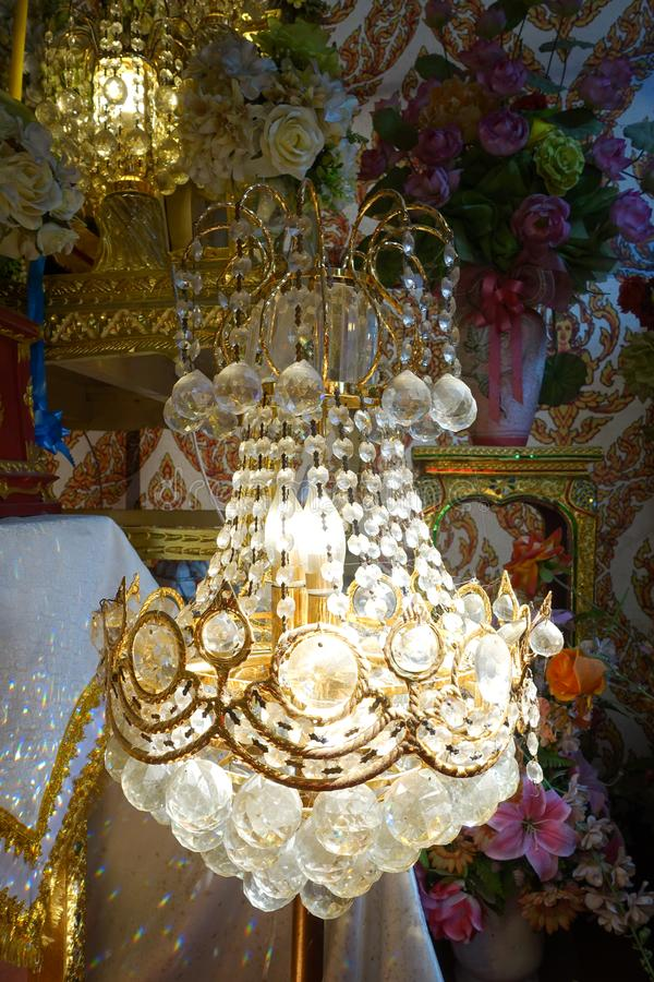Chandelier with crystal pendants. In temple stock image