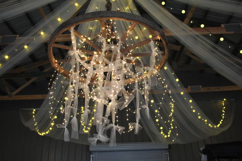 Homemade Chandelier. Country living - homemade chandelier set up for a country wedding stock photography